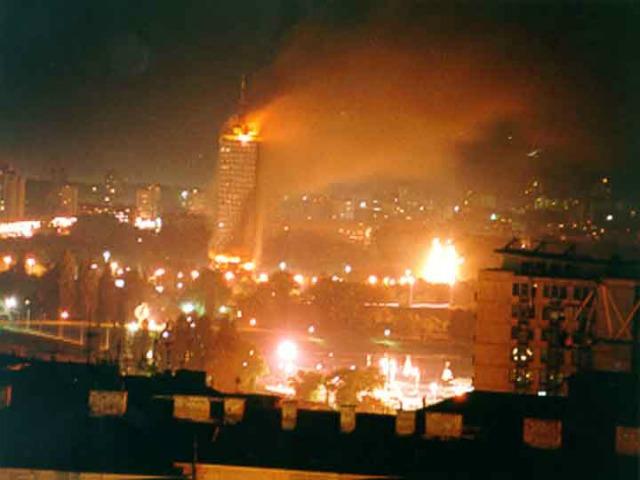 https://balkaninsight.com/wp-content/uploads/2017/05/slika-2-ck-building-on-fire-1999.jpg