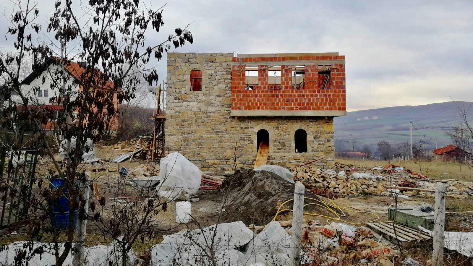 On Heritage Budget, Replica 'Stone' Houses Commemorate Kosovo War